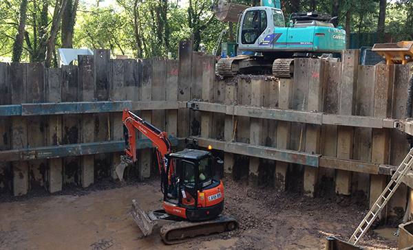 Sheet piling with vibratory hammers