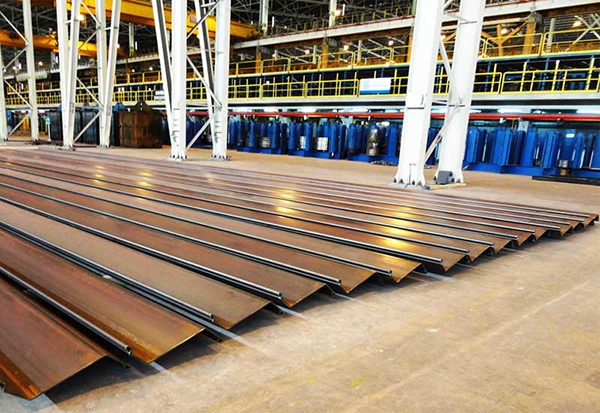 Stability of Breakwater Foundation Reinforced with Steel Sheet Piles under Dynamic Loading